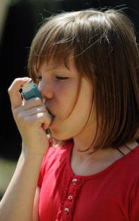 Young Asthma patient using an inhaler